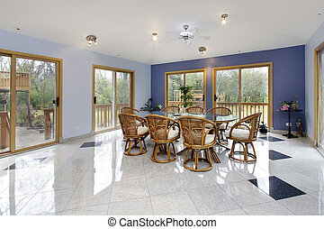 Large eating area with doors to patio