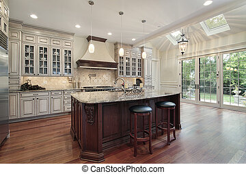 Kitchen with skylights - Kitchen in luxury home with two...