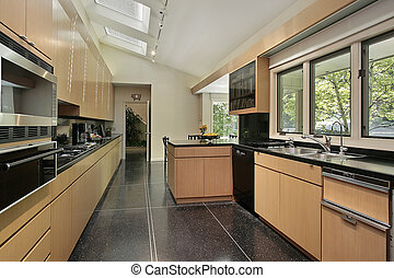 Kitchen with black speckled flooring