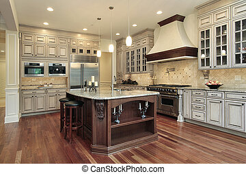 Kitchen with rectangular island - Kitchen in luxury home...