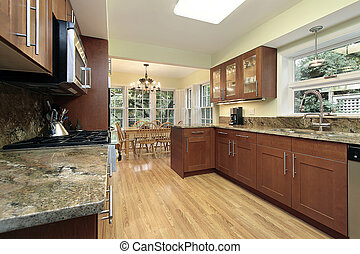 Kitchen with windowed eating area - Kitchen in suburban home...