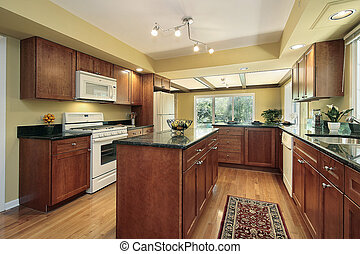 Kitchen with black granite counters