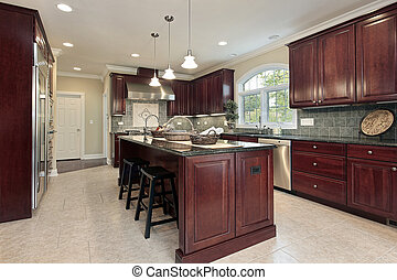Kitchen with cherry wood cabinetry - Kitchen in luxury home...