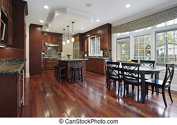 Kitchen with cherry wood flooring