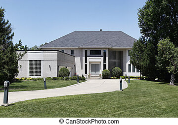 Luxury home with curved garage window - Luxury home with...