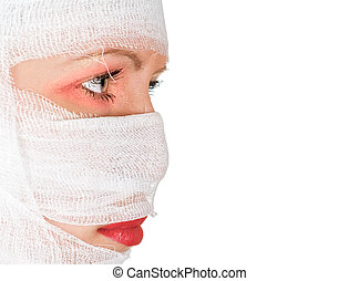 bandages - girl with bandages on her face on white