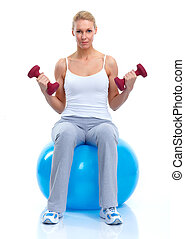 Young woman with dumbbells.