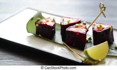 snack roll from beets served with lime