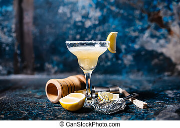 Margarita alcoholic beverage, fancy cocktail with lime garnish and lemons