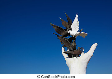 Kusadasi Peace monument - Peace monument against a blue sky...