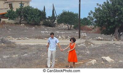 lovers walking in a field