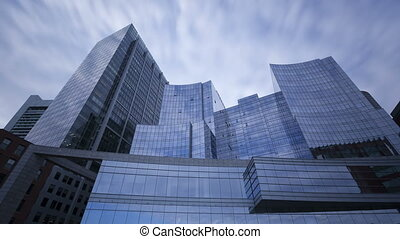 4K Time lapse glass skyscrapers - 4K Time lapse of...