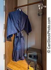 bathrobe - Blue bathrobe hang in wardrobe