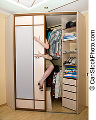 cupboard - Young lovely couple in bedroom cupboard concept