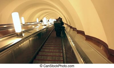 stairs down escalator - escalator motion silhouette of a...