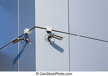 Two security cameras - A security cameras on the side of an...
