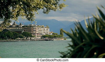 Lake Geneva, a picturesque pond between high mountains -...