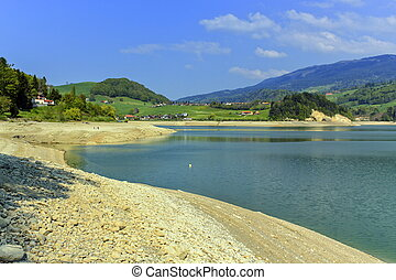 Gruyeres lake in summer, Fribourg canton, Switzerland - Dry...