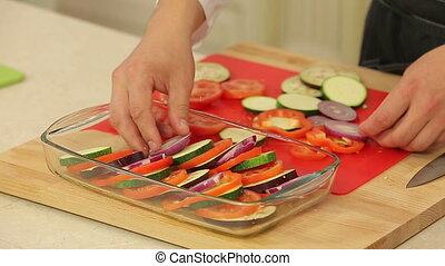 Chef is cooking ratatouille - Chef is mixing freshly cut...