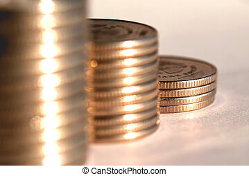Coins stacked in bars The concept of revenue growth