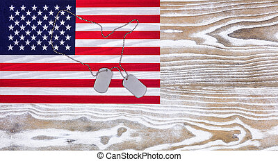 USA Flag and military ID tags on fade white wood background...
