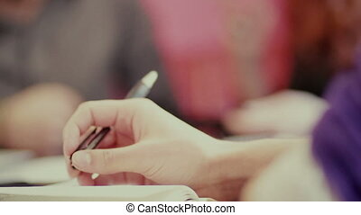 hands hold a pencil during a conversation