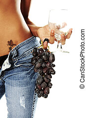 Need wine - An empty wine and fresh grapes held by a...