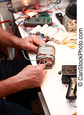 Senior electrician - Photo of senior electrician working -...