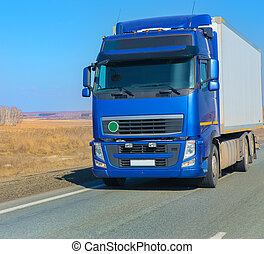 truck on country highway - big truck on country highway on...