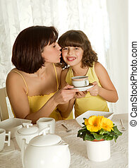 Coffee for mothers day - Little girl serving coffee for...