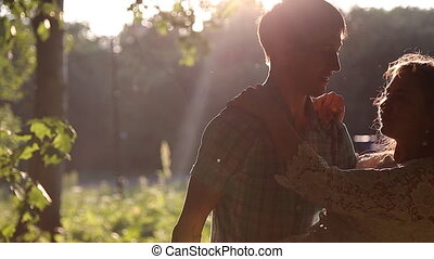 Young couple embracing at sunset
