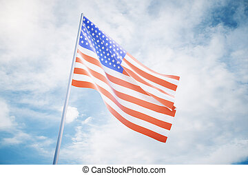Waving american flag on a sky background