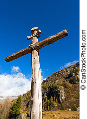Wooden Cross - Italian Alps - Old wooden cross (trunks of...