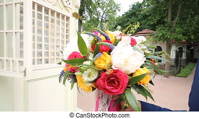 groom gives the bride a beautiful wedding bouquet - groom...