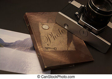 Old retro camera with photo album - old retro camera with...