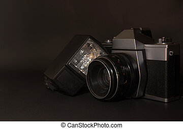 Old retro camera on black backgroun - old retro camera on...