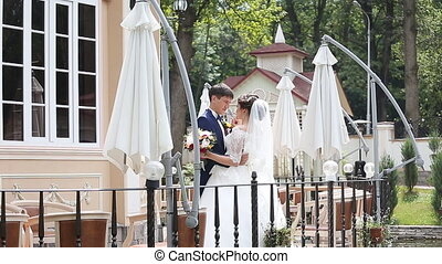 Groom and Bride in a park. wedding dress. Bridal wedding...