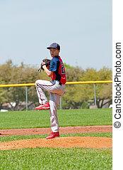Teen Baseball pitcher - Teen boy baseball pitcher about to...