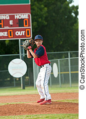 Teen baseball boy ready pitch from the mound.