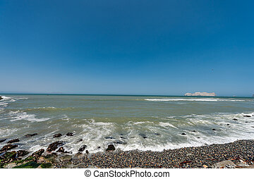 Pacific Ocean in Lima Peru with Coastline. San Lorenzo island in background