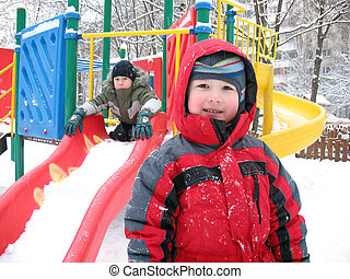 childs on playground - The boys at a children\'s play area