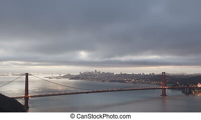 4K Time lapse zoom out sunrise Golden Gate Bridge with San...
