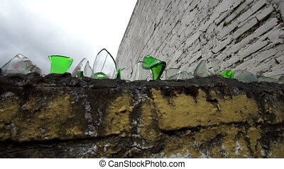 Glass Shard Topped Wall Handheld - Handheld close up shot of...