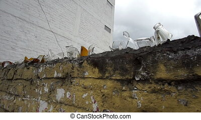 Broken Glass Topped Wall Handheld - Handheld close up shot...