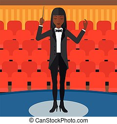 Conductor directing with baton. - An african-american woman...