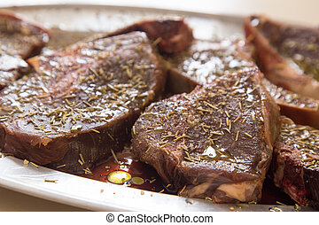 Venison steaks marinating - locally hunted platter of...