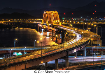 banghwa bridge at night over han river - banghwa bridge with...