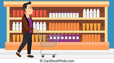 Customer with trolley - A man pushing an empty supermarket...