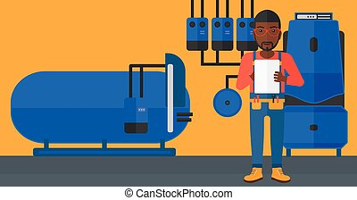 Confident builder with tablet - An african-american man...