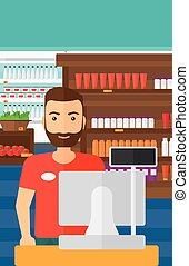 Salesman standing at checkout. - A salesman standing at...
